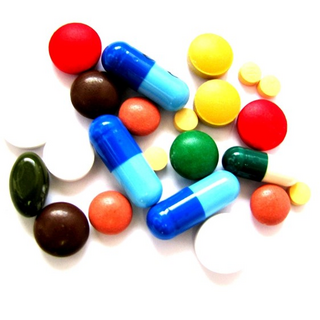 Pills / Drugs / Tablets (By Victor on Flickr https://www.flickr.com/photos/v1ctor/7035932329)